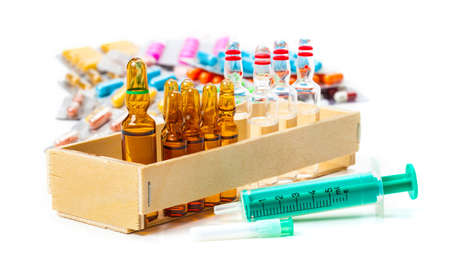 vaccinate: Disposable syringe, ampoules, vaccines, tablets Stock Photo