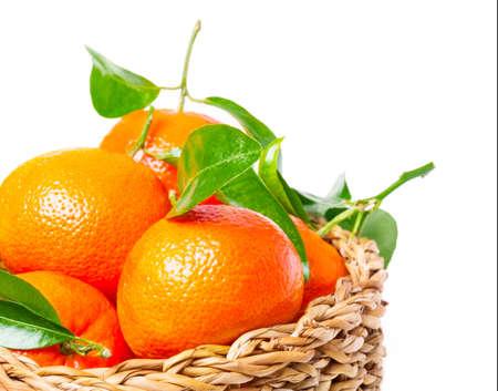 Leaf clementines in basket