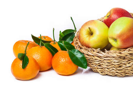 clementine fruit: Basket of fruit, apples, leaf clementines Stock Photo