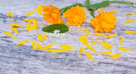 globules: Marigolds, globules, homeopathy Stock Photo