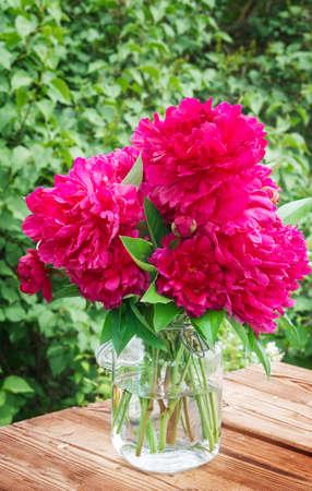 garden table: Peonies on garden table