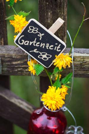 garden gate: Garden Time, label at the garden gate