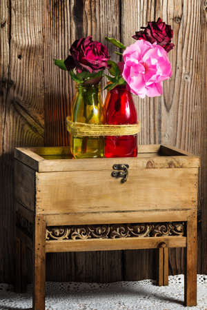 transience: Roses on wooden tables