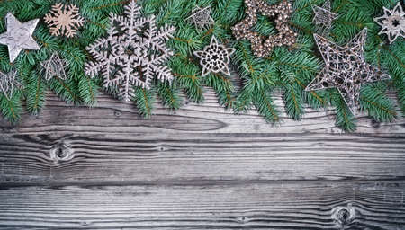 christmas tree decorations: Silver christmas decoration with fir on wood Stock Photo