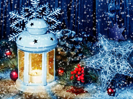 snowstorm: Christmas decoration with lantern in snowstorm Stock Photo