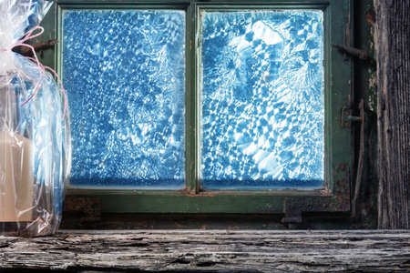 windowpanes: Gift on old windowsill