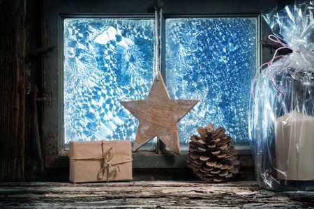 shelf ice: Christmas decoration in front of window