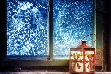 windowpanes: Red lantern in the window Stock Photo