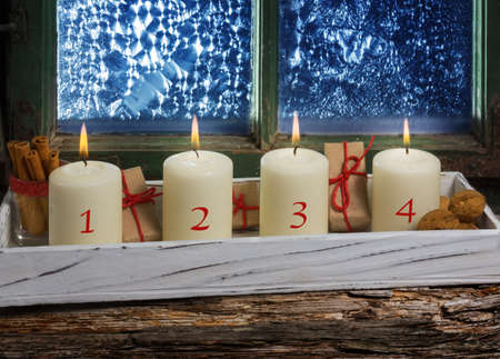 windowpanes: Advent decoration, four candles on window