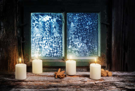 windowpanes: Fourth Advent, Christmas decoration with candles