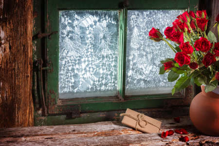 windowpanes: Roses and gift in window Stock Photo