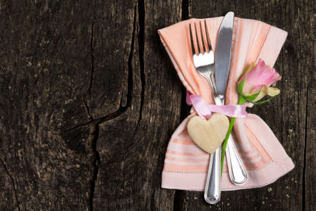 Cutlery for Valentines Day on wooden Imagens