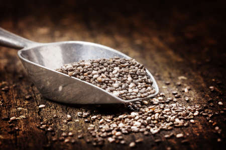 nutriment: Chia seeds in pot and on spoon