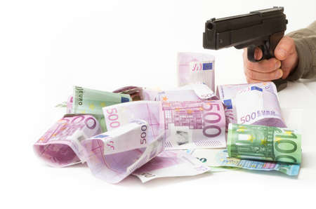 raid: Money, gun, bank raid Stock Photo