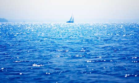 Sea, sailboat on the horizon Stock Photo