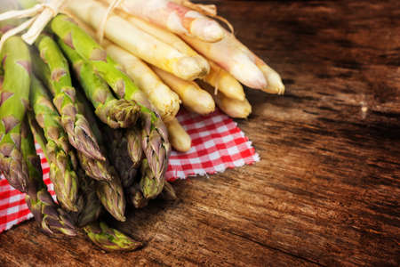 White and green Asparagus on wood
