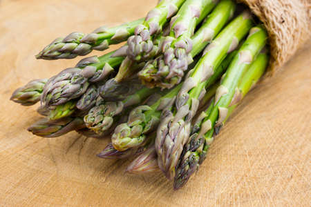 Green asparagus on wood Stock Photo