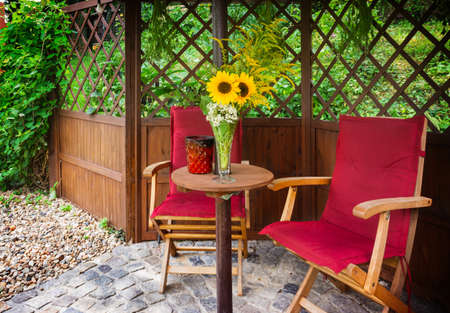 seating area: Seating area with sunflowers in the Garden Pavilion Stock Photo