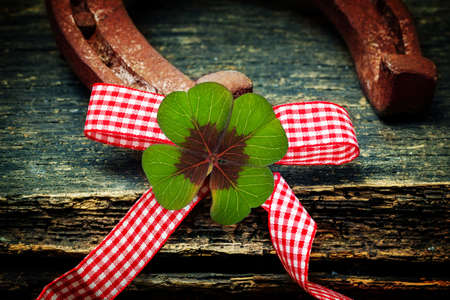 Lucky clover, horseshoe and bow tie  Stock Photo