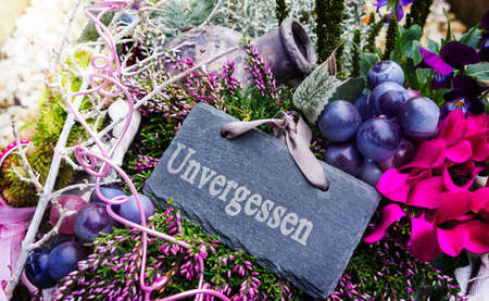 Grave decorations in the autumn with slate unforgettable