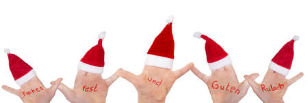 Childrens hands with Santa hats wish Merry Christmas and Happy New Year