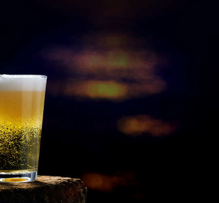Beer, beer glass on wooden table in dark pub