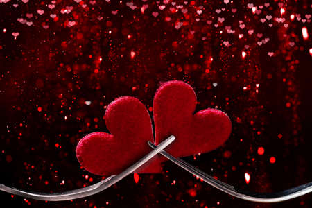 Valentines Day, hearts and forks against bokeh background