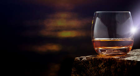 Whiskey, whisky glass on the wooden table , banner