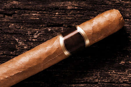 Cigar is on the wooden table Imagens