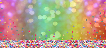 Colorful confetti in front of colorful  with bokeh for carnival Imagens