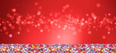 Colorful confetti in front of red   with bokeh for carnival