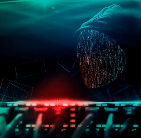 Anonymous computer hacker with hood and faceless Imagens