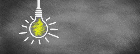 Light bulb shines on slate, have an idea