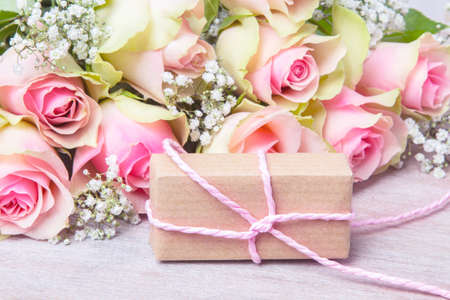 Pink roses and gift for Valentines Day, birthday