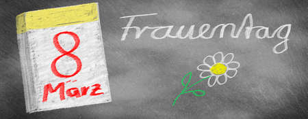 Womens Day - March 8, calendar sheet and flower drawn on slate blackboard