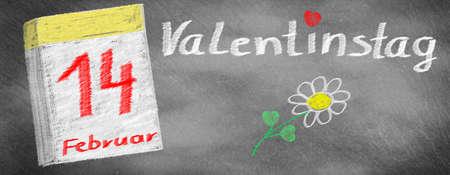 Valentines Day -14. February, calendar and flower, drawn on slate blackboard Imagens