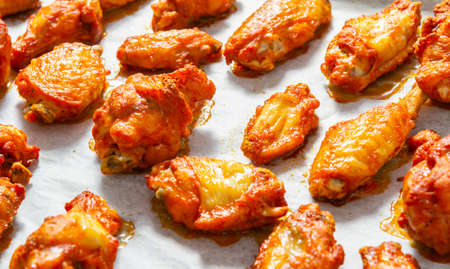 Crispy fried chicken wings on the baking tray Imagens