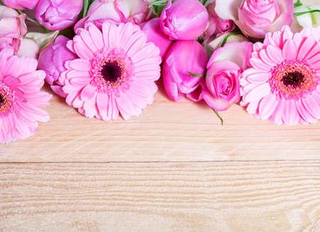 Pink flowers on wood - gerbera, roses, tulips