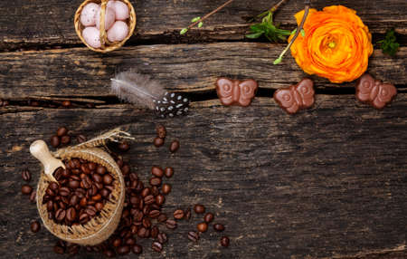 Coffee beans and Easter decoration with ranunculus blossom