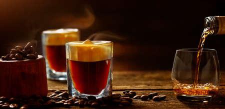 Irish coffee - coffee and whiskey against dark background Standard-Bild