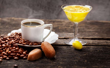 Coffee and eggnog, decoration for easter on dark wooden table Standard-Bild