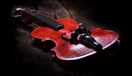 Violin on wood, dark background