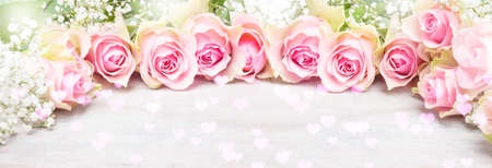 Pink roses and gypsophila, greeting card for Valentine's Day, banner 免版税图像 - 139602062
