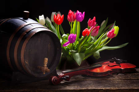 Tulips with a wine barrel, beer barrel or whiskey barrel and a violin