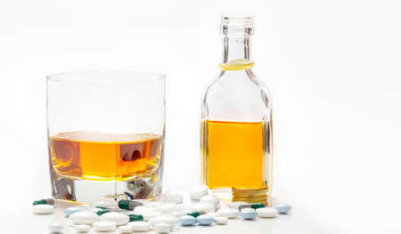 Medicines and alcohol isolated on white background, addictive Standard-Bild
