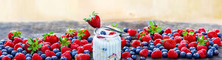Many different berries as a banner, Healthy breakfast with yoghurt