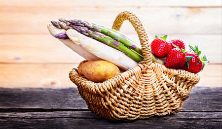 Asparagus, strawberries and potatoes in the basket