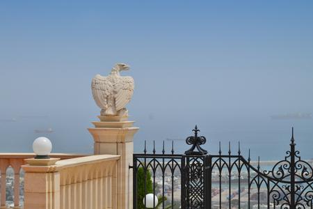 marble statue high above the sea in the Bahai gardens in Haifa in open sea photo