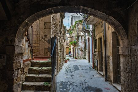 Old houses on the Ortygia isle - old town of Syracuse on Sicily island, Italy