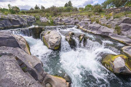 Waterfalls of Alcantara river near Castiglione di Sicilia village, Sicily in Italy Stock Photo